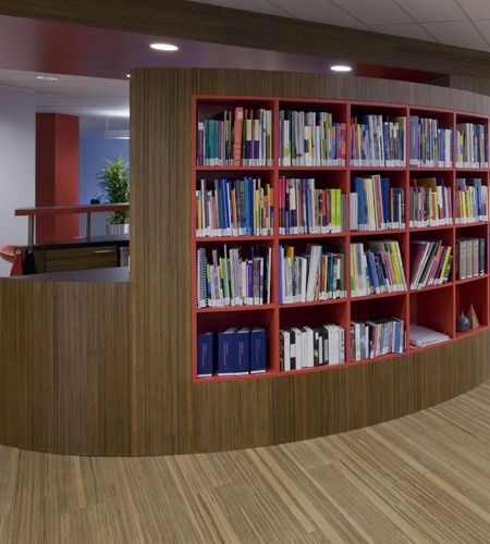 Plexwood® Child Services detail of a coffee bar in meranti curved comprised veneer plywood paneling
