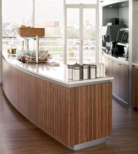 Plexwood® Consultancy Firm floor with kitchen counter for the top-floor restaurant in re-lined surface ply veneers