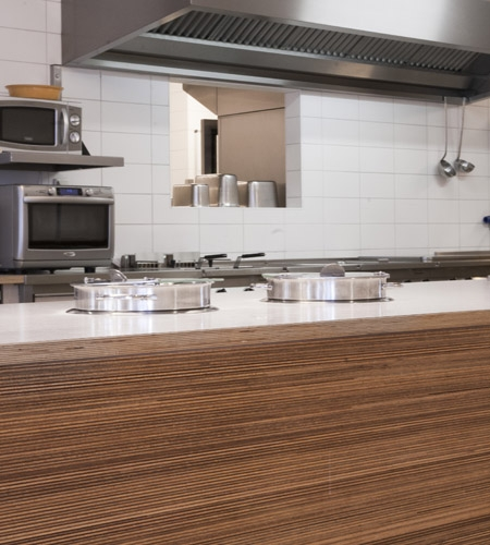 Plexwood® De Beerendonk Nursing House professional kitchen counter front in meranti maltese stacked plywood