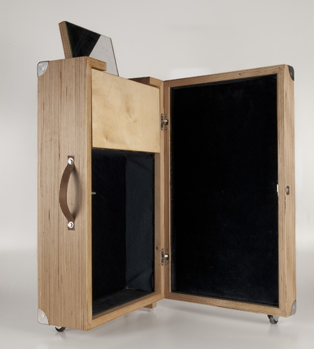 Plexwood® HOUTd half-open detail of a lovely birch wooden honeymoon suitcase with beauty case section and mirror