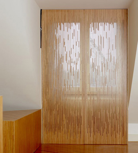 Plexwood® MuZIEum see-through window shutters in ocoumé vertical cut plywood veneer panels