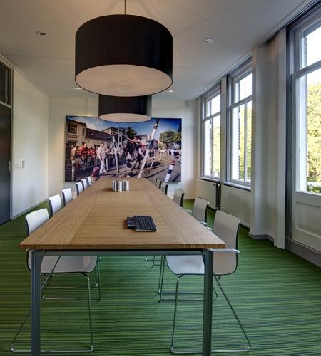 Plexwood® Nedbase geometric patterned meeting room table with sliced-up oak plywood surfacing veneer