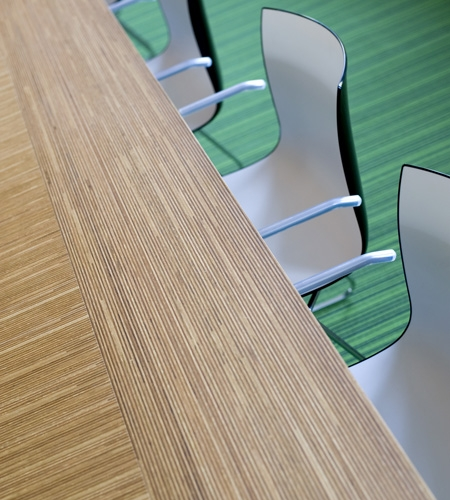 Plexwood® Nedbase detail of a large meeting room table with modern oak parquetry