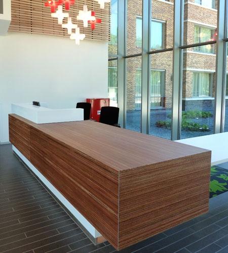 Plexwood® Parnassia central hallway reception desk in meranti architectonical veneer ply paneling