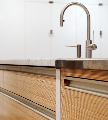 Plexwood® Kitchen detail with drawer in birch vertically sliced-up plywood strip veneer