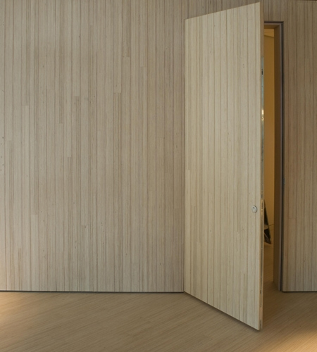 Plexwood® Rabobank floor and partition wall with incorporated door in pine/ocoumé reconstructed plywood laminate