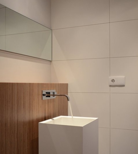 Plexwood® Private home bathroom wall detail in V313 mdf panel with re-clamped birch composite plywood veneer