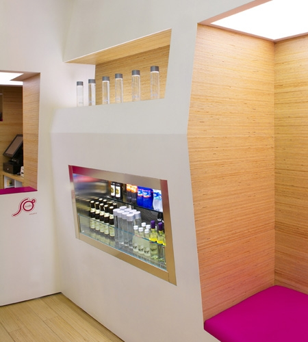 Plexwood® SoSushi detail of the sushi bar interior cladding with wall and floor in birch up-lined veneer panels