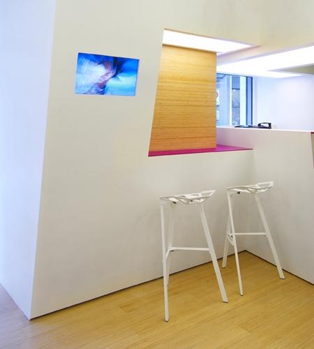 Plexwood® SoSushi parquet and wall detail of dining area in a sushi bar in birch sideways plywood