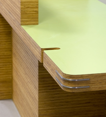 Plexwood® St. Olav's detail of a hospital desk in sandwich composite pine plywood with green HPL to