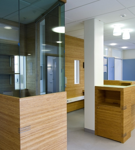 Plexwood® St. Olav's standing desk detail with storage cabinet of pine engineered micro-edge veneer panels