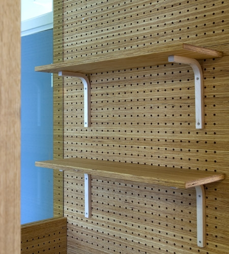 Plexwood® St. Olav's detail of a wall from cnc perforated acoustic panels in natural pine smart composite ply