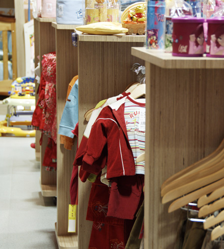 Plexwood® Ta Ti Top clothes display in eco birch architectural ply lining veneer