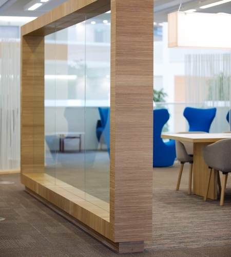 Plexwood® Co-op Group hq made of sustainable oak comprised surface veneer paneling