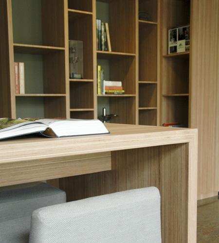 Plexwood® Tree Nursery Van den Berk detail of table with bookcases in reconstructed edged plywood veneer