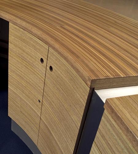 Plexwood® Van Hall Larenstein University curved door detail of the central information desk in meranti up-lined veneer