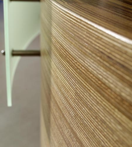 Plexwood® Van Hall Larenstein University curved top and front detail of the meranti glued-up plywood information desk