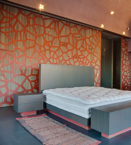 Plexwood® Residential bedroom back wall cladding and cabinetry in meranti with copper ornamentation