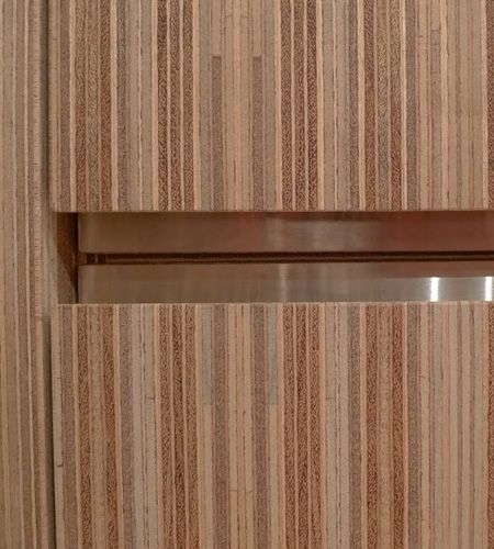 Plexwood® Storage cabinet detail in meranti stacked standing plywood sandwich veneer panels with RVS