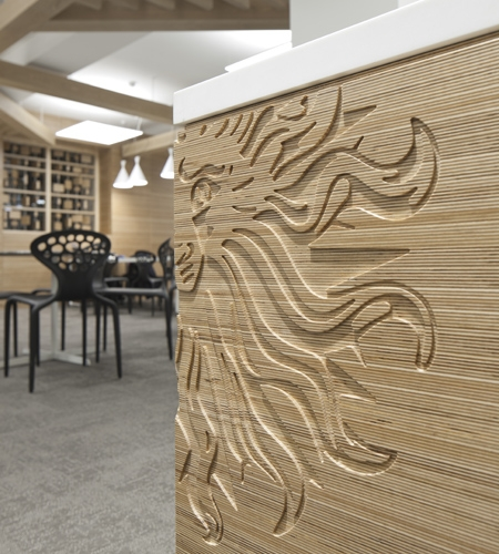 Plexwood® Publicis on Baker Street office, reception desk area with cnc-cut company logo decoration