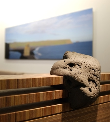 Plexwood® Iceland Air Keflavik airport Saga lounge wall detail with meranti partition wall and lava stone