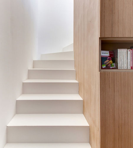Plexwood® Andrea Mosca design, sleeping attic stairwell with cupboard detail of Beech plywood panels