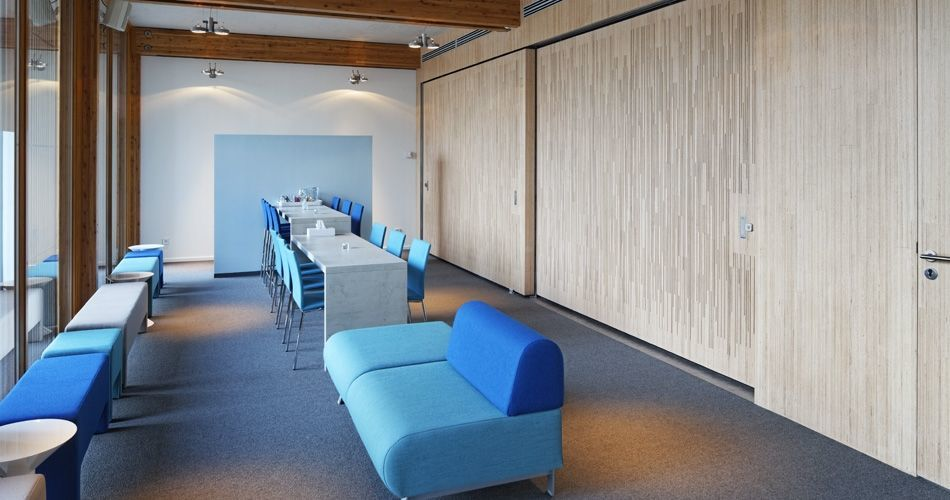 Plexwood® Cemetery De Nieuwe Ooster waiting room wall covering with semi-transparent doors in birch