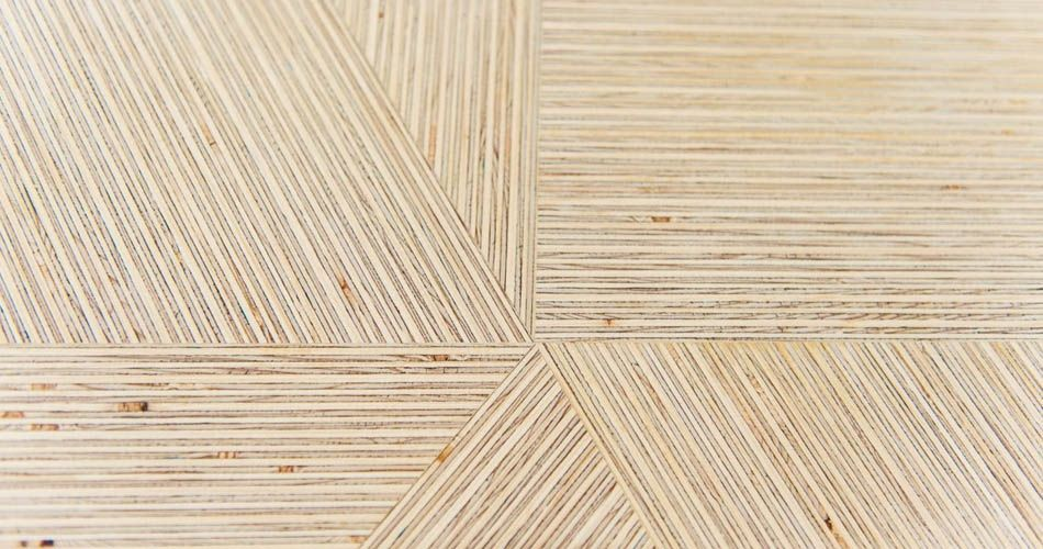 Plexwood® Deuvel design table surface detail with solid engineered deal geometric formed pattern