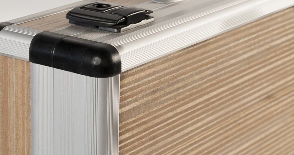 Plexwood® Gefken beech carrying case edge detail with engineered resurfaced micro-ply edge veneer sheets in metal framework