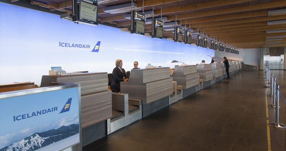 Plexwood® Iceland Air Keflavik airport check-in desks in meranti fire retardant safety design paneling
