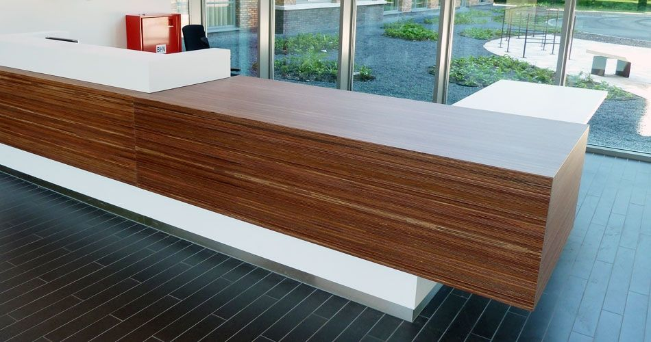 Plexwood® Parnassia, Institute for Mental Health reception desk in meranti modified composite veneer