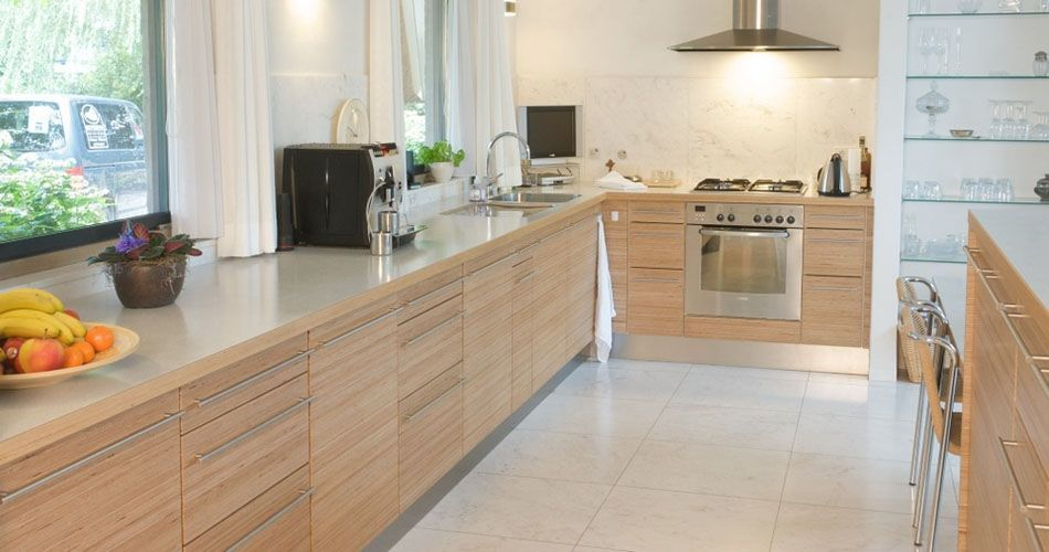 Plexwood® Eat-in kitchen overview with kitchen cabinetry in natural birch re-stacked plywood veneer