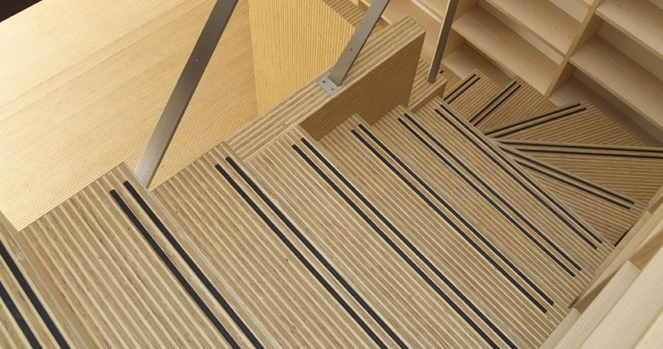 Plexwood® Rietveldplan private home detail of a staircase and floor in deal veneer of end-glued plywood edges
