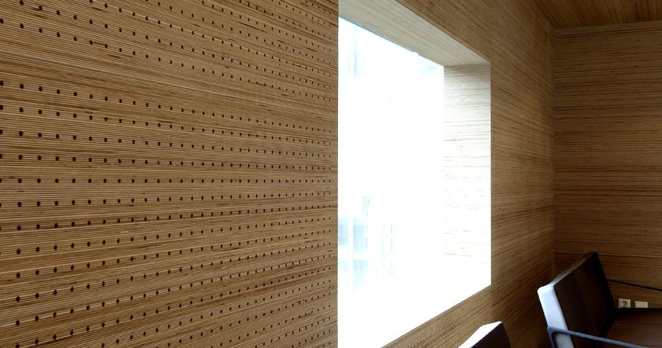 Plexwood® St. Olav's architectonical wall with window in perforated birch re-clamped edge-grain plywood veneer