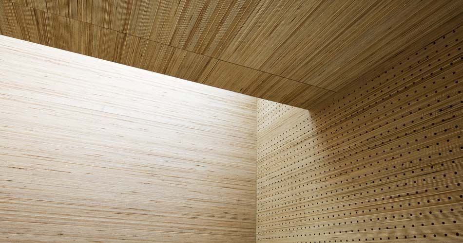 Plexwood® St. Olav's ceiling detail with cnc routed acoustic perforations with birch stacked veneer ply paneling