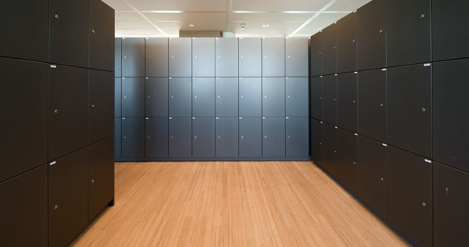 Plexwood® Tax Office and Border Security floor detail in locker room in beech parquet contrariwise glued-up plywood
