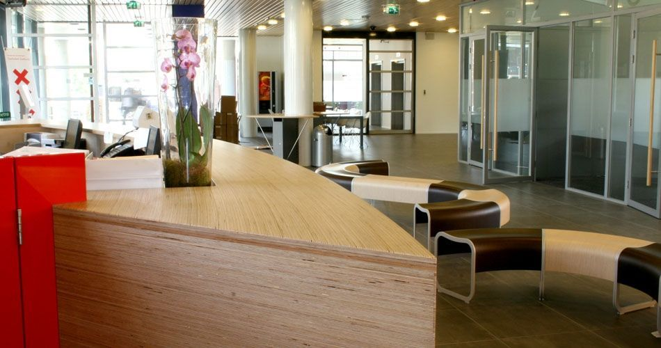 Plexwood® Zeeburg Community District Office friendly curved reception viewed from the top in birch re-ply veneers